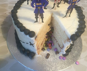 chocolate beans inside a cut open pirate party cake