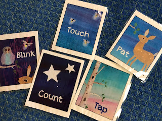 laminated activity cards that say blink, count, touch, pat, and tap