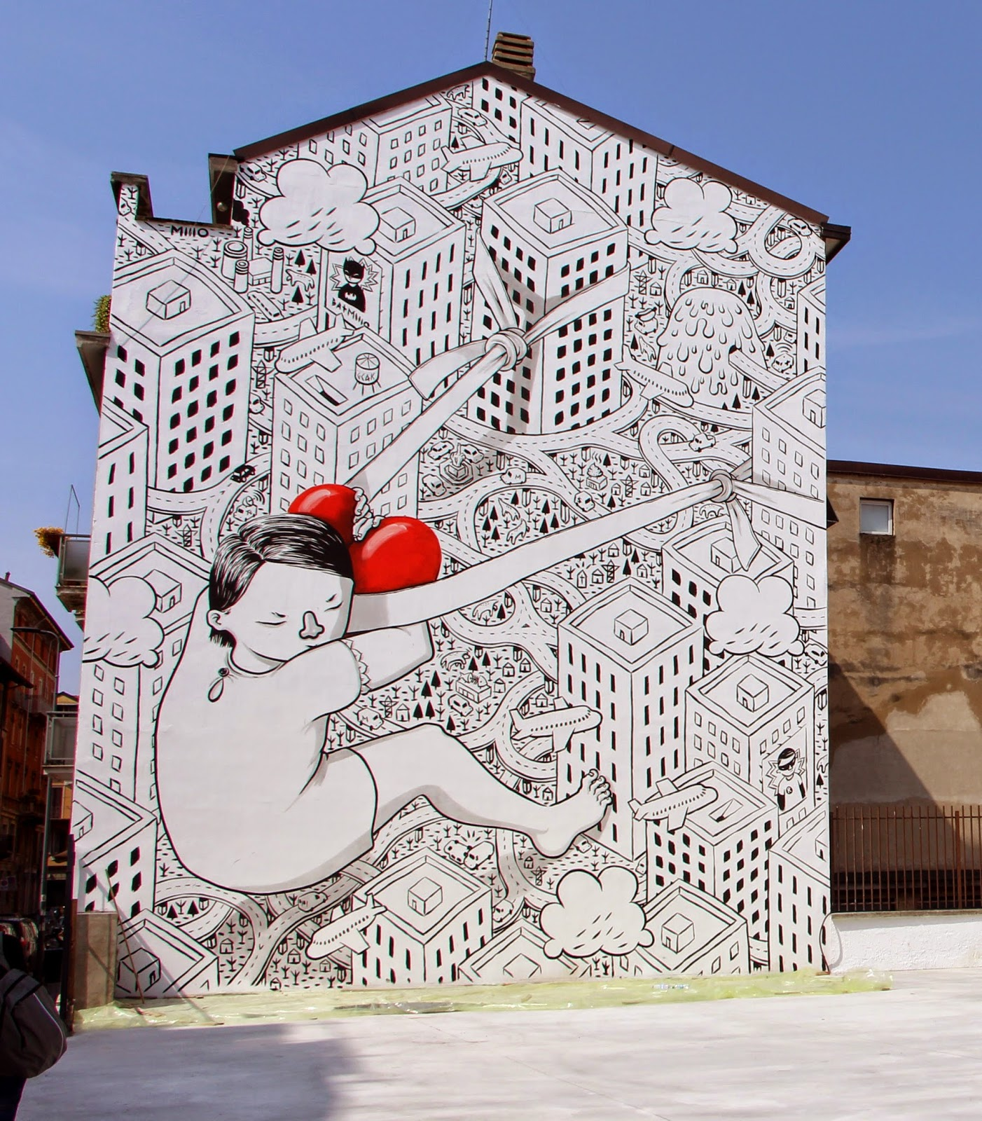 While you discovered the first piece a few days ago, Millo has now wrapped up the second part of his massive project in Milan, Italy.