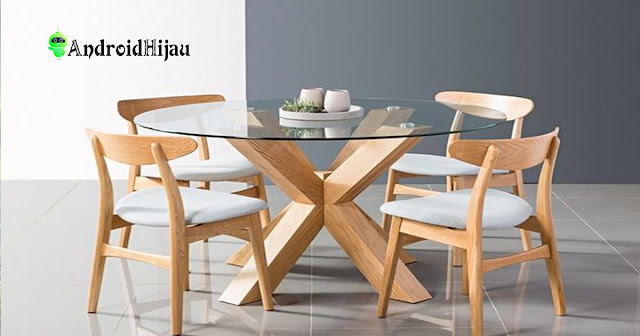 Meja makan kaca bulat sangat cocok diaplikasikan pada desain rumah kecil sederhana