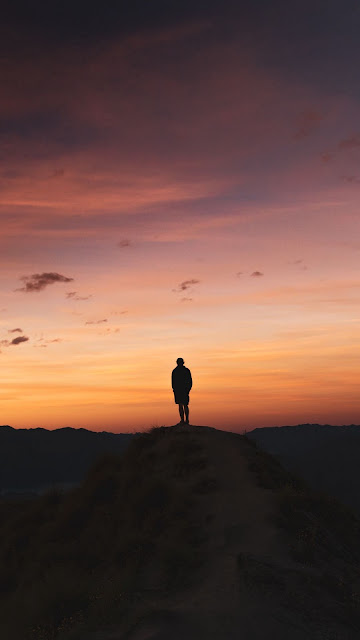Lonely man, sunset clouds, mountain, landscape
