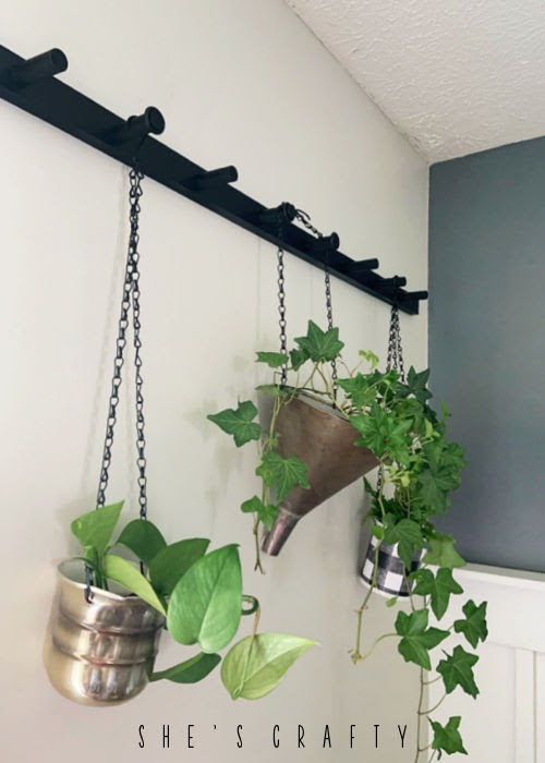 Hanging Plant Holders made from found items like a metal funnel.