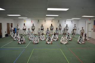 Taekwondo black belts wearing masks during COVID-19