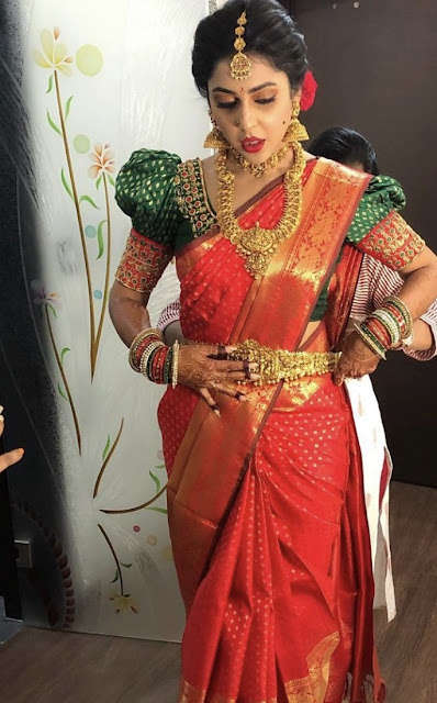 Bride in Nakshi Haram Heavy Odiyanam