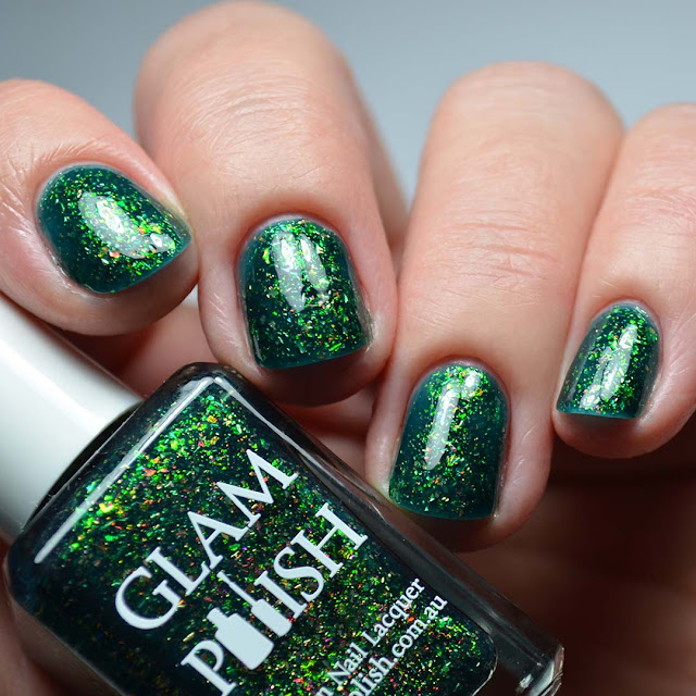 green flakie nail polish swatch different lighting
