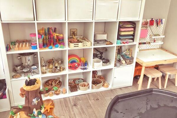 Ikea flisat table skadis pegboard desk with kallax playshelves in playroom