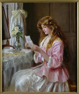 Beautiful girl is reading the letter