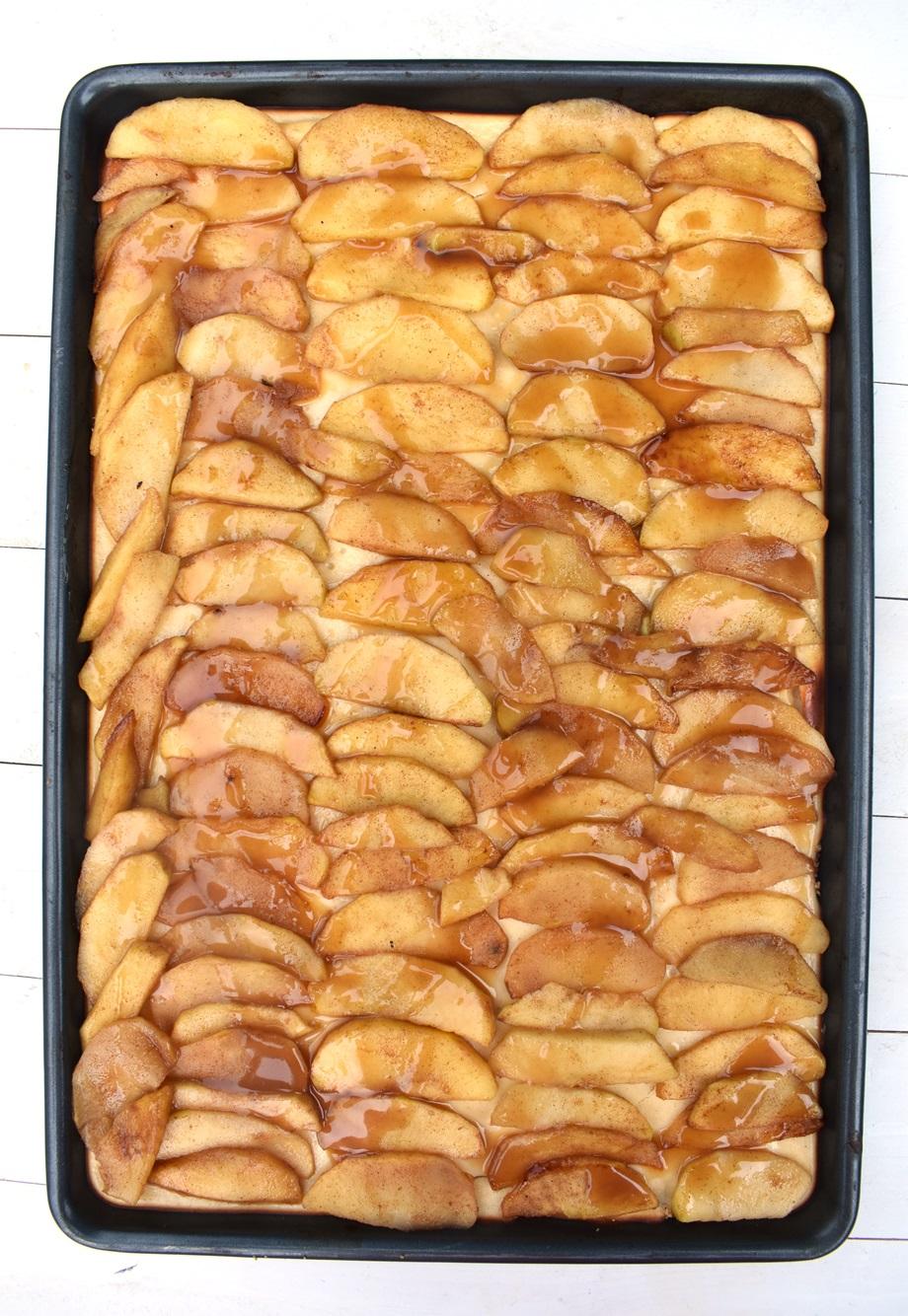 sheet pan of cinnamon apple cheesecake bars