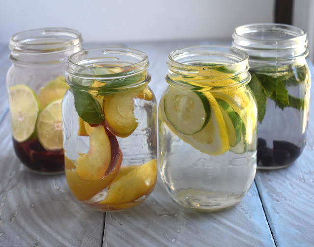 Infused water in 4 different flavors for a super refreshing, no-sugar added drink- lemon cucumber, peach basil, blueberry mint and cherry lime! www.nutritionistreviews.com