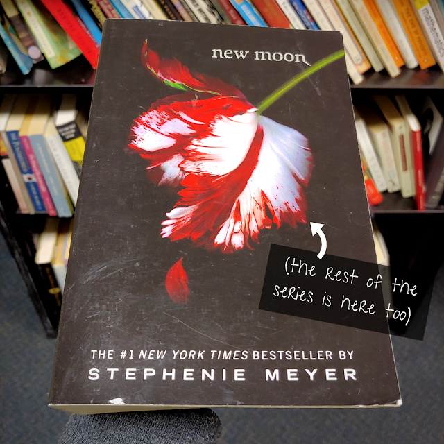 """cover of the book """"New Moon"""" by Stephenie Meyer. A caption reads """"the rest of the series is here too"""""""