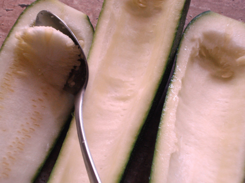 Scoop the seeds from the middle of each zucchini half