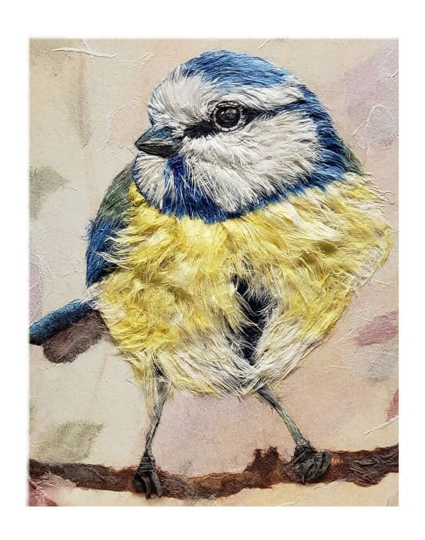 blue and yellow bird with soft feathers composed of hanji fibers