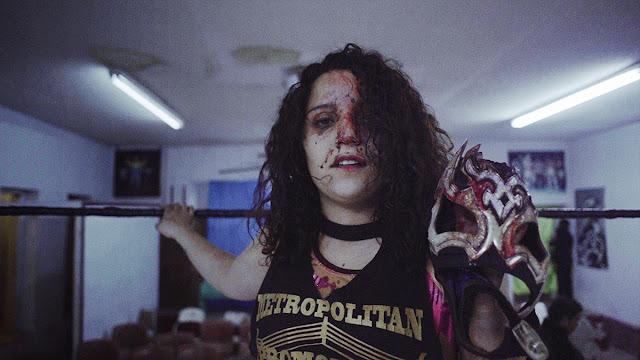 bloody female mexican wrestler