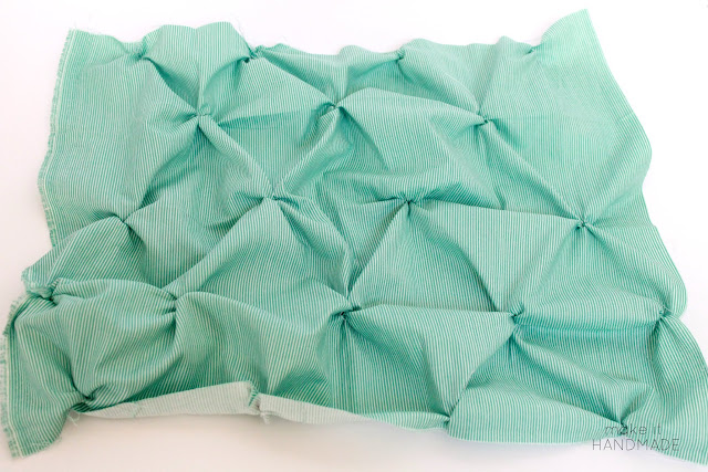 The Twist Pillow-- Free tutorial for a fun smocked throw pillow. | www.makeithandmade.com