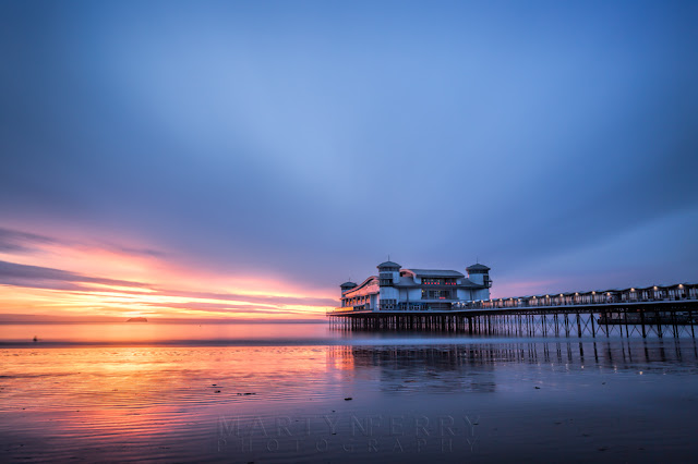 Long exposure image of stormy clouds over the Grand Pier in Weston-Super-Mare