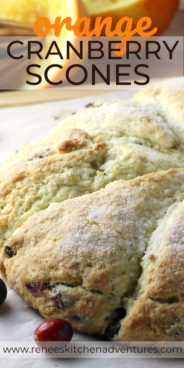 Easy Orange Cranberry Scones by Renee's Kitchen Adventures pin with image of scones on a board and text overlay for Pinterest