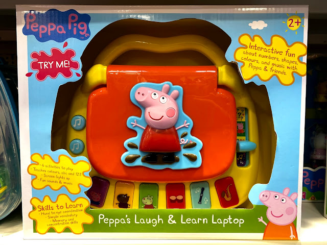 Peppa's Laugh & Learn Laptop in packaging with a large cut out so the toy can be seen and touched while in the toy shop