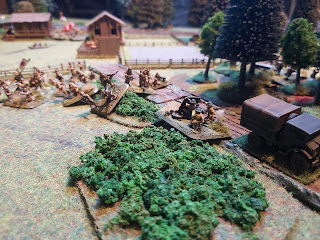 The British 2 pounders are attacked by the Japanese infantry