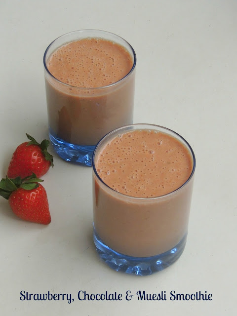 Chocolate and strawberry smoothie with muesli