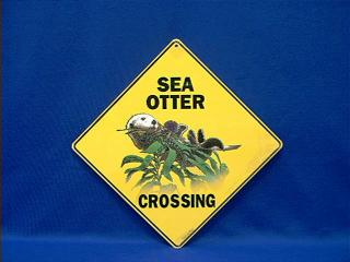 sea otter crossing sign