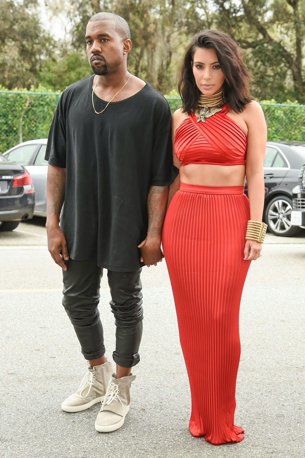 Kim Kardshian in a pleated red cropped top and skirt at the Roc Nation Pre-Grammy Brunch in Beverly Hills