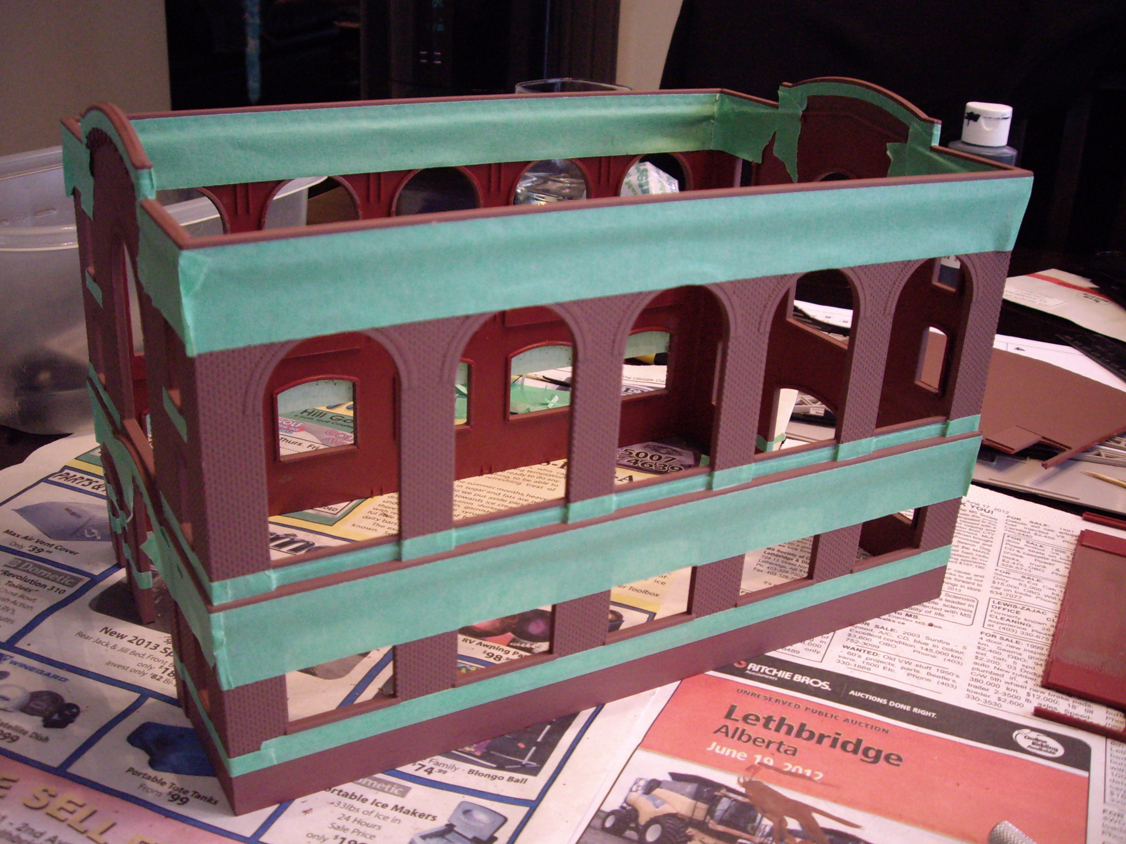 Northern Light & Power kit with green masking tape around windows and building trim