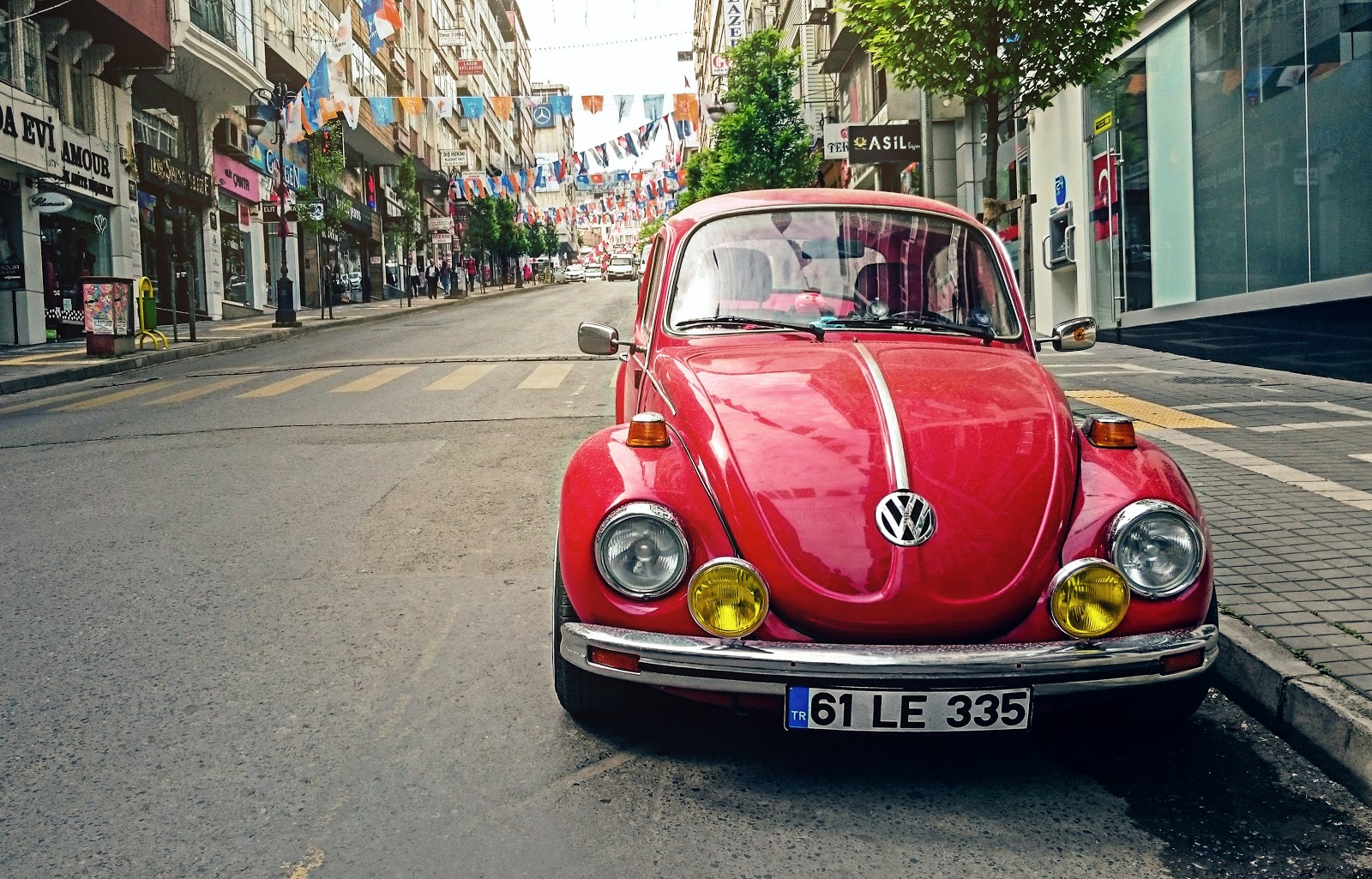 red-volkswagen-beetle-parked-at-roadside-near-pedestrian-car-pictures