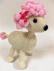 http://www.ravelry.com/patterns/library/pomp-a-puppy#