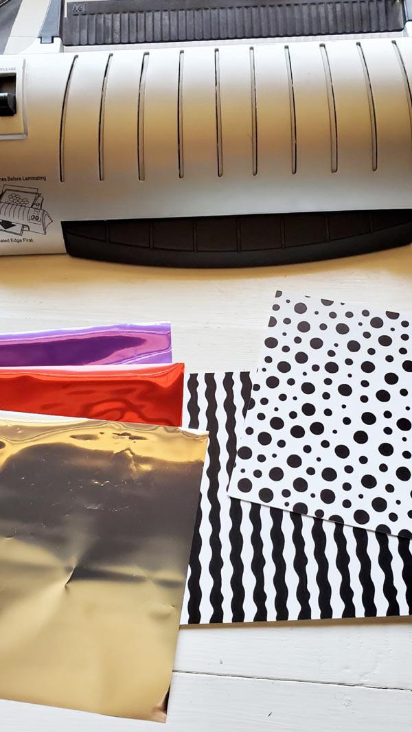Supplies Needed for Foil Bookmarks:  Heat Laminator Laura Kelly Foil Sheets Laura Kelly Toner Paper Laura Kelly Stamps (Sprinkle Kindness) Paper Ink Acrylic Block Scissors Mounting Square Foam Adhesive Roller Colored Pencils Twine Hole Punch