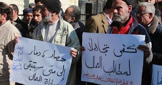 عمال غزة ضحايا سماسرة «السجلات التجارية»