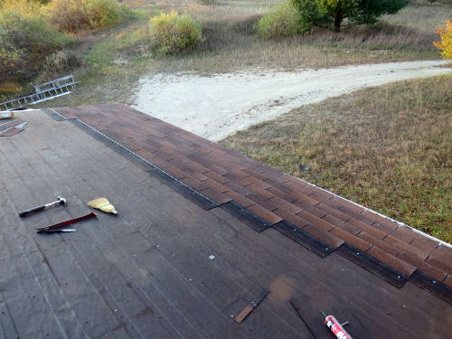 new shingles on the edge of a roof