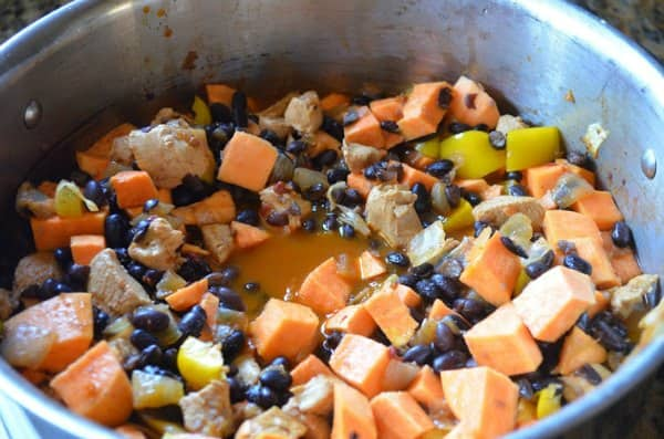 Black Beans, Sweet Potato, Bell Pepper added to Sweet Potato Chili Recipe in Soup pot.