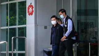 Officials of two Hong Kong newspapers charged under security law, say police