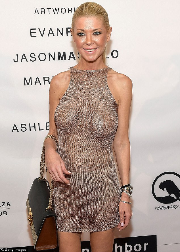 Tara-Reid-flashes-her-boobs-in-braless-dress-2