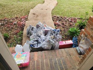 Bags and trays of food delivered at Alynda's front door step