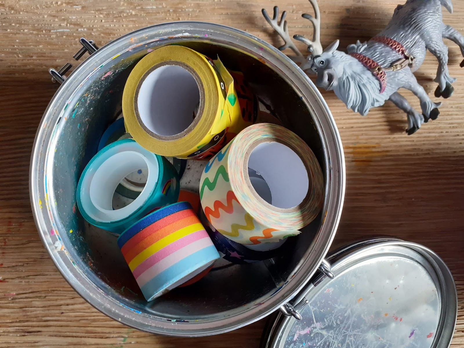 Rolls of washi tape in a tin
