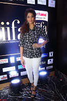 Ritika Singh in Black Printed Shirt and White Leggings at IIFA Utsavam Awards press meet 27th March 2017 06.JPG