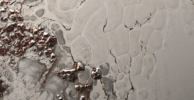 "Scientists from NASA's New Horizons mission used state-of-the-art computer simulations to show that the surface of Pluto's informally named Sputnik Planum is covered with churning ice ""cells"" that are geologically young and turning over due to a process called convection. Image Credit: NASA/Johns Hopkins University Applied Physics Laboratory/Southwest Research Institute"