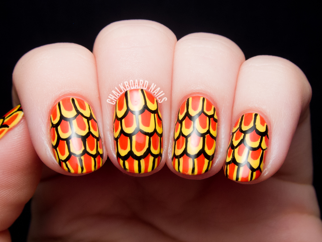 Stylized goldfish scale nail art by @chalkboardnails