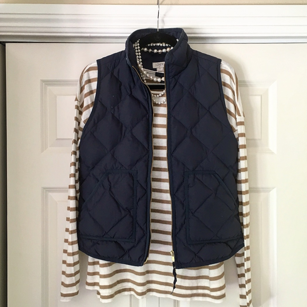navy puffer vest and striped tee
