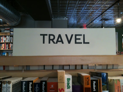 TRAVEL section sign with huge space between the A and V so it looks like TRA VEL