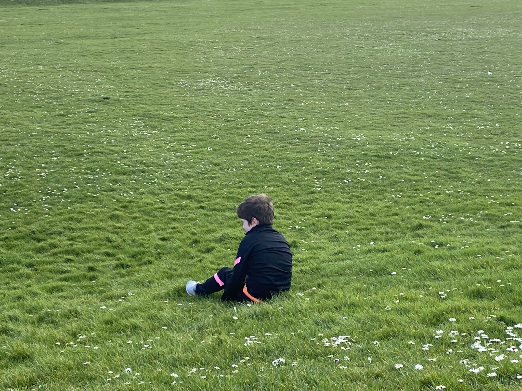 Boy sat on the grass