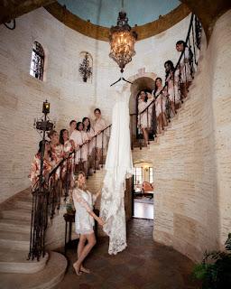 bridesmaids and bride looking at wedding dress