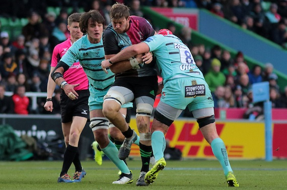 Stephan Lewies of Harlequins is tackled by Ben Morgan of Gloucester