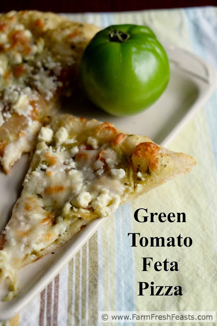 This vegetarian pizza showcases green tomatoes at their finest--topped with feta and mozzarella cheese on a garlic scape pesto-spread crust.