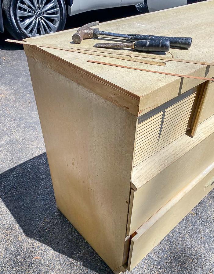 Removing damaged veneer