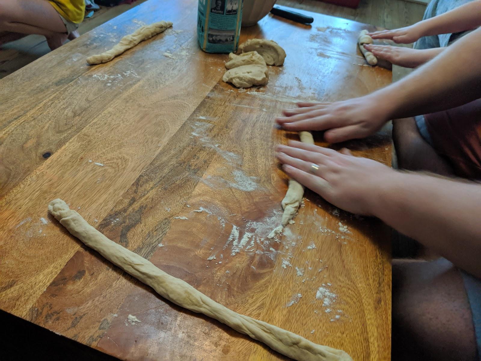 Holiday Memories : Making Pretzels at Home  - rolling pretzel dough