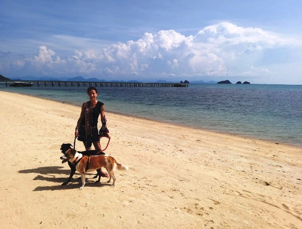 Anne with her dog on a Thailand beach