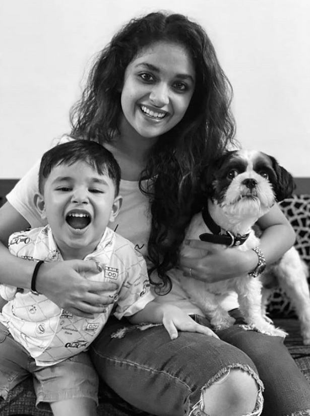Keerthy Suresh with Lovely Smile with a Cute Boy and Lovely Pet Dog Nyke