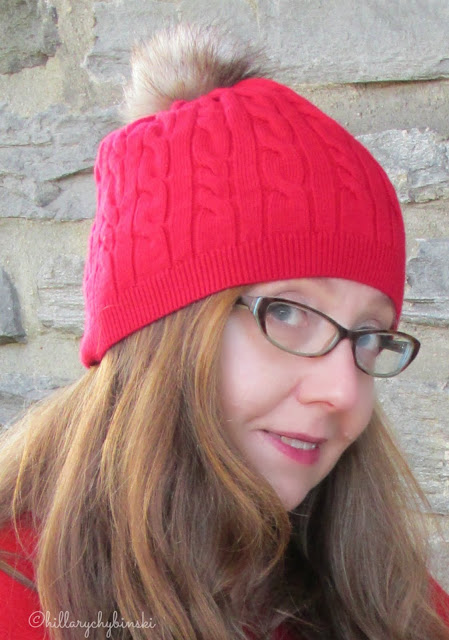 Red Knit Hat with a Fur Pom-Pom